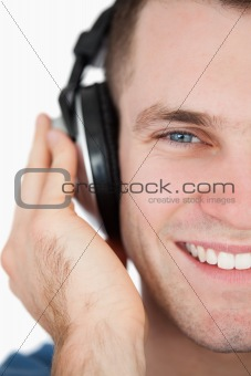 Close up of a smiling man listening to music