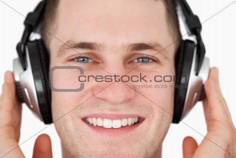 Close up of a happy man listening to music