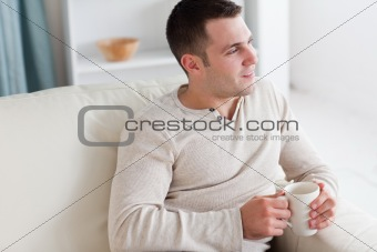 Attractive young man having a tea