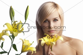 beauty blond girl with yellow lily