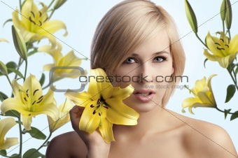 beauty shot of blond girl with lily