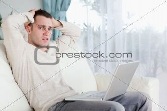 Sad man working with his laptop