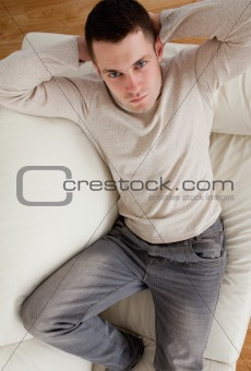Portrait of young man resting on a sofa