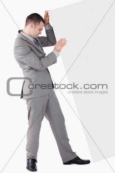 Portrait of businessman pushing a blank panel