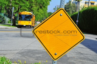 blank traffic sign and school bus