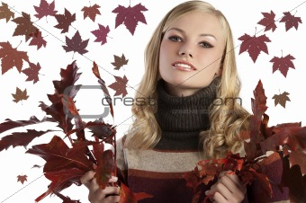 natural blonde beauty holding some autumn leaves