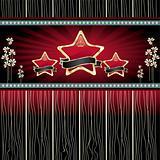 three gold stars with ribbon