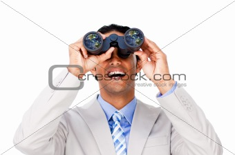 Happy businessman looking through binoculars