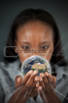 Woman holding a glowing Earth