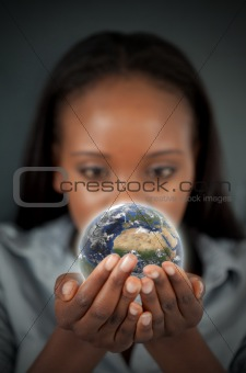 Beautiful woman holding the Earth
