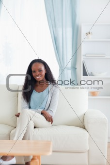 Woman sitting in livingroom