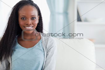 Close up of woman sitting on sofa