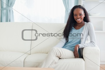 Woman leaning against armrest