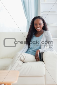 Smiling woman leaning against armrest
