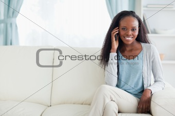 Woman phoning on couch