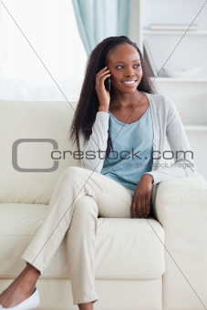 Close up of woman with cellphone on sofa