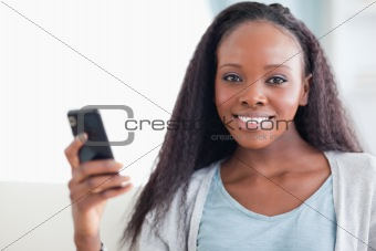 Close up of woman with her cellphone