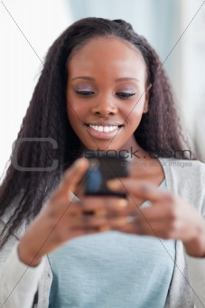 Close up of happy woman reading text message