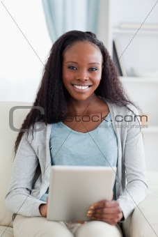 Close up of woman using tablet on sofa