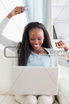 Close up of young woman happy about online shpooing