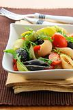 pasta salad with tomatoes and arugula in the Italian style