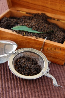 tea strainer with a fragrant black tea