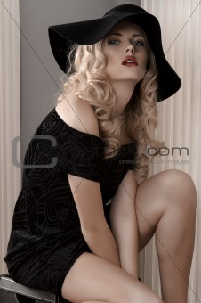 fashion portrait of a young lady dressed in black