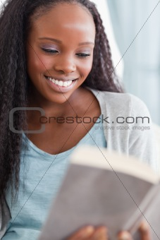 Close up of woman reading a book