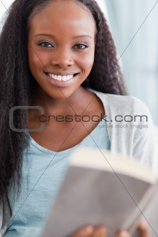 Close up of smiling woman reading