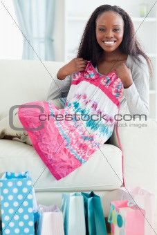 Close up of woman with her shopping on couch