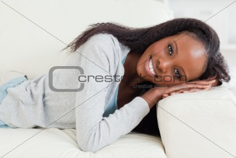 Close up of woman lying on the sofa