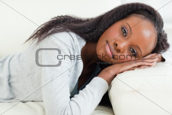Close up of woman resting on couch