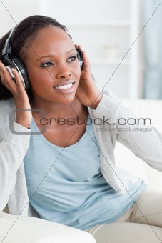 Close up of woman enjoying music on the couch