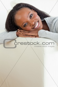 Close up of woman taking a moment off on couch