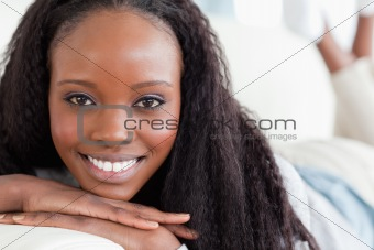 Close up of smiling woman on the sofa