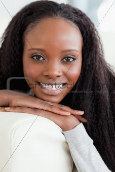 Close up of smiling woman lying on the sofa