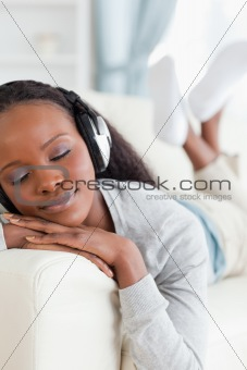 Close up of woman enjoying music on couch