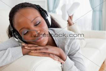 Close up of woman relaxing with music on her sofa