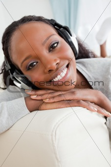 Close up of woman enjoying music on her sofa