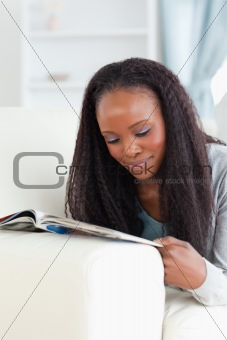 Close up of woman with booklet on couch