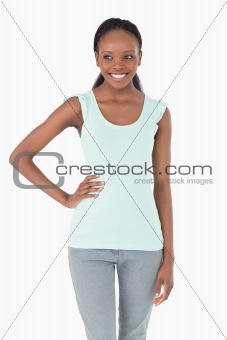 Close up of woman with one arm akimbo on white background