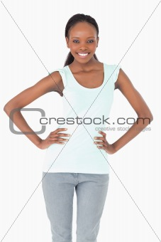 Close up of woman with arms akimbo on white background