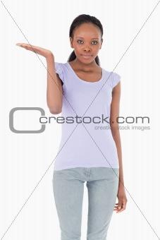 Close up of woman holding something up on white background