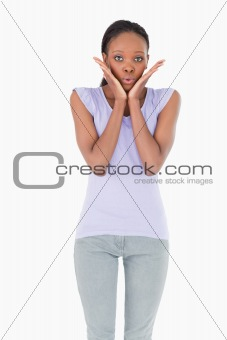 Close up of surprised woman on white background