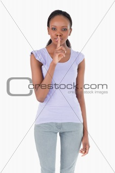 Close up of woman asking for silence on white background