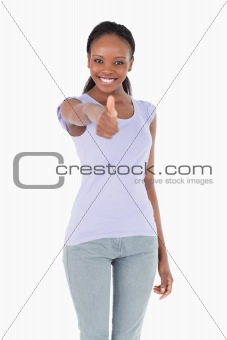 Close up of woman giving thumb up on white background