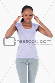 Close up of woman rubbing her temples on white background