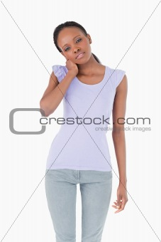 Close up of woman holding her neck on white background