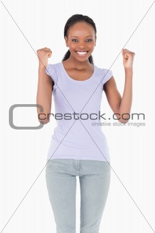 Close up of woman celebrating success on white background