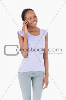Close up of woman on her phone on white background